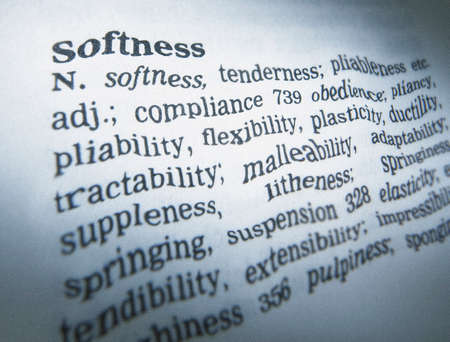 Close up of thesaurus page showing definition of the word softness