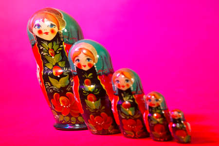 Russian dolls on pink red background