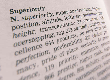 Close up of thesaurus page showing definition of the word superiority
