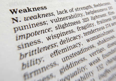 Close up of thesaurus page showing definition of the word weakness 写真素材