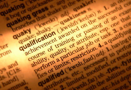 Close up of dictionary page showing definition of the word qualification Stock Photo