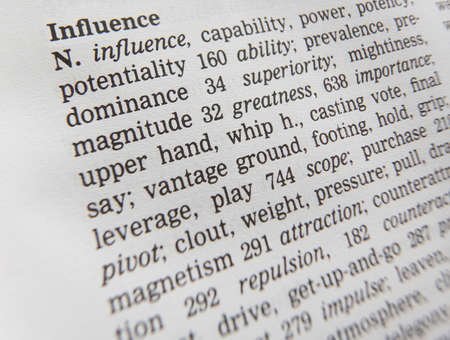 Close up of thesaurus page showing definition of the word influence