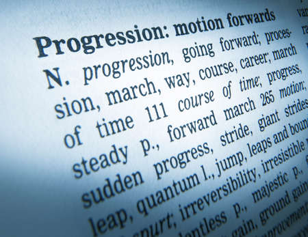 Close up of thesaurus page showing description of the word progression