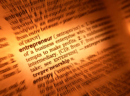 Close up of dictionary page showing definition of entrepreneur