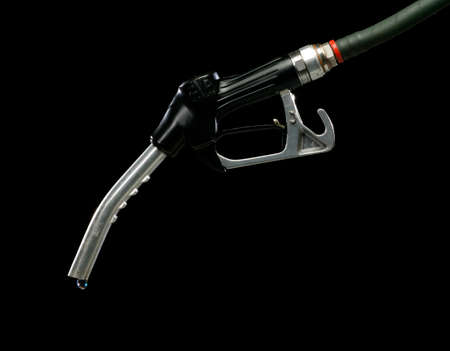 Gas pump with single drop of fuel isolated on black background