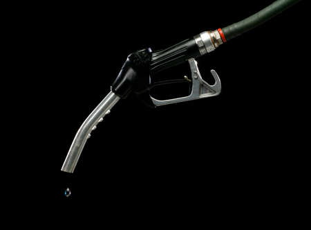 GAS PUMP WITH SINGLE DROP OF FUEL ON BLACK BACKGROUND
