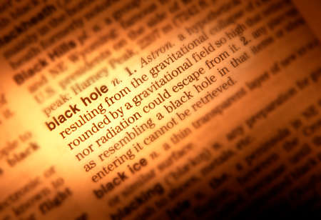 Close up of dictionary page showing definition of black hole