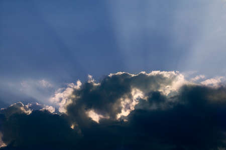 Sunlight breaking through clouds creating silver lining