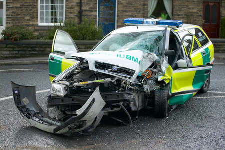 Volvo V40 ambulance wrecked in collision on emergency call Banco de Imagens