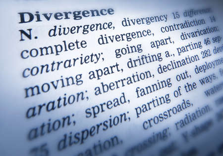 Close up of thesaurus page showing description of the word Divergence Imagens