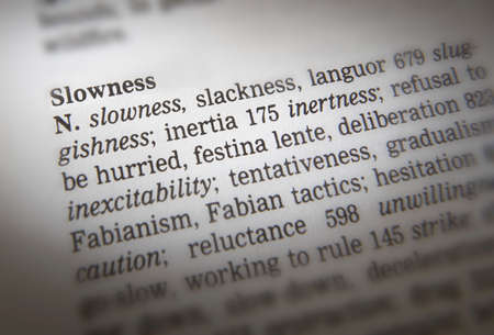 Close up of thesaurus page showing description of the word slowness