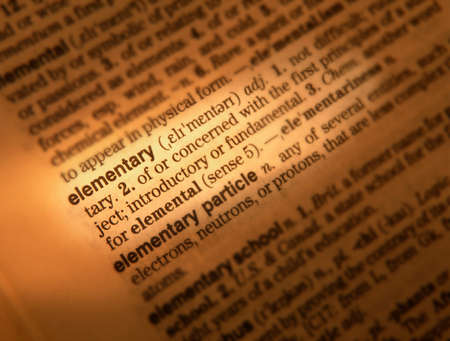 Close up of dictionary page showing definition of the word elementary