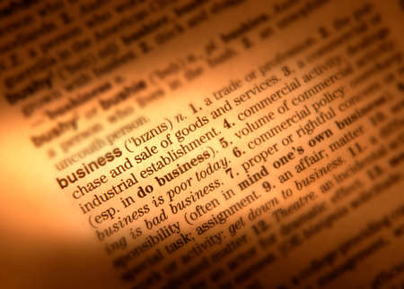 Close up of dictionary page showing definition of the word business