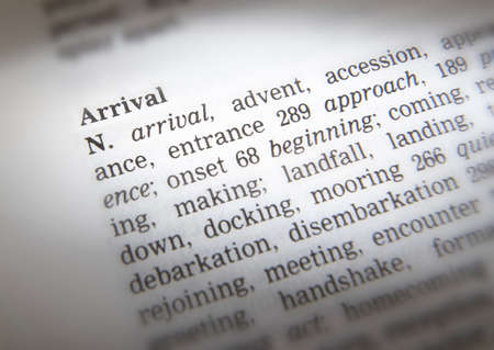 Close up of thesaurus page showing description of the word Arrival