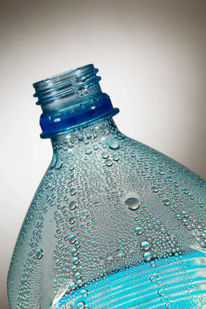 Water droplets condensing inside plastic bottle in close up Stock Photo