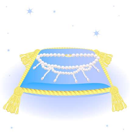 joyas de oro: contra una almohada azul grande de fondo blanco con borlas de oro y un collar de perlas