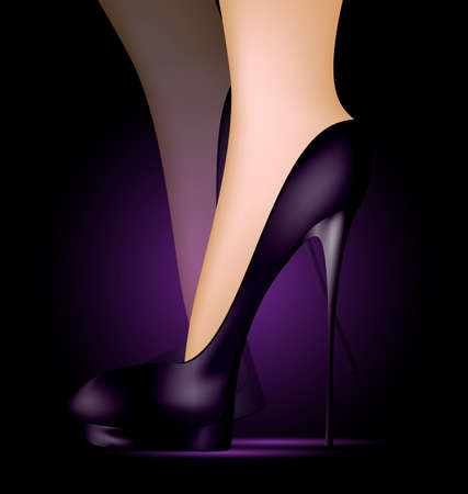 heelpiece: dark background and feet in black ladys shoes