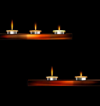 dark background and burning candles on the wooden stand