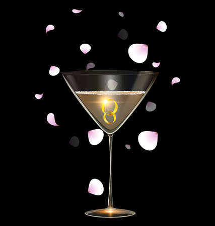 black background and the large glass of champagne with couple of golden jewel rings inside, light falling petals