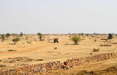 desert road: Tractor on a desert road