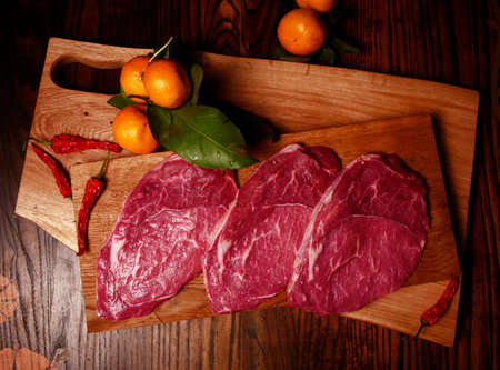 chili's restaurant: Raw meat on a cutting board