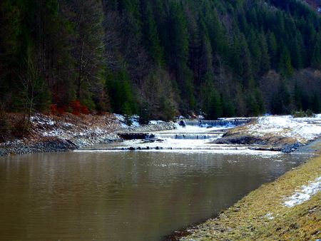 mud snow: melting snow and a small dam ,