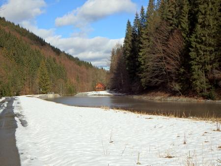 ice dam: small gazebo in winter landscape, small dam