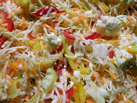 Fresh sliced colorful vegetable salad closeup photo