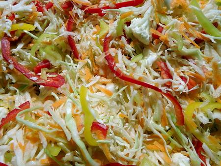 Fresh sliced colorful vegetable salad - background