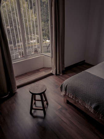 Room with large window and wooden floor Archivio Fotografico