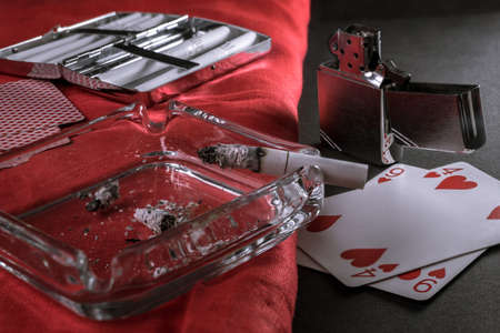 lit cigar in ashtray and a nice lighter 免版税图像