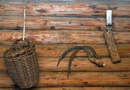 Peasant instruments of labour. Interior of old russian izba. Central Russia. photo