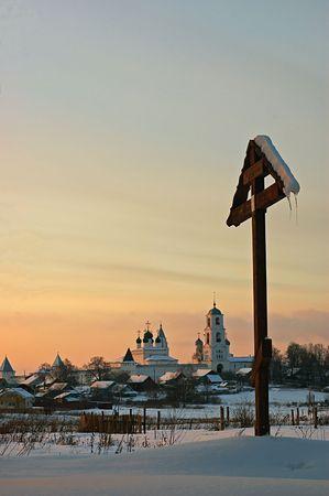ortodox: Russian ortodox monastery and cross at sunset.