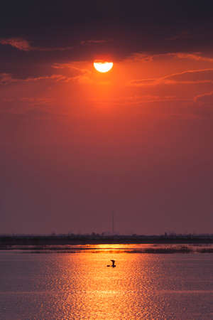 fishingpole: Fishermen on sunrise on the lake