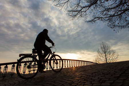 bicycle silhouette: Silhouette of a man on muontain-bike, sunrise