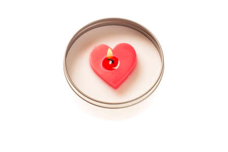heart burn: Heart shaped candle burning