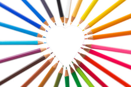 creative tools: Coloured pencils in the form of heart Stock Photo