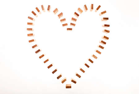 naivete: Dominoes standing in heart shape