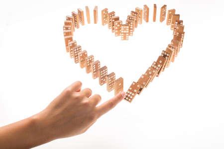 divorce: En forma de corazón Domino Rally Falling Foto de archivo