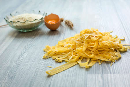 home made: Home made pasta on wooden ground