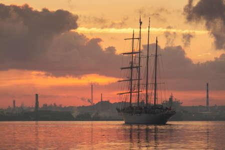 Sail boat at sunrise in Havana port, Cuba