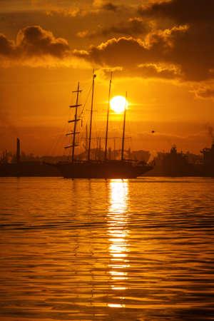 caribbean cruise: Sail boat at sunrise in Havana port, Cuba
