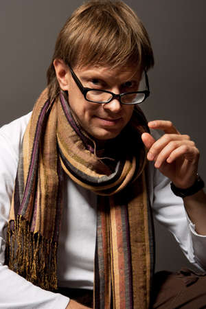 lifted hands: smiling handsome in glasses and scarf isolated