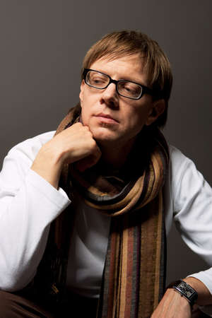 thinking handsome in glasses and scarf isolated