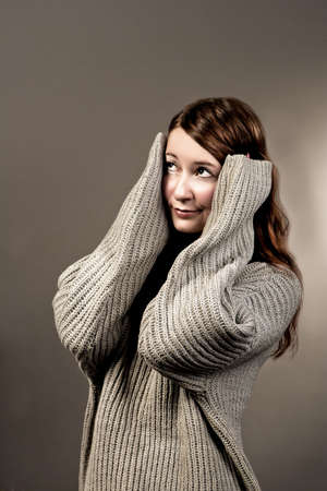 surprised young girl in sweater isolated