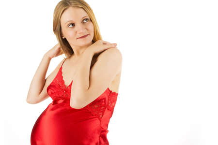sensual young pregnant blonde in red nightshirt isolated on white photo