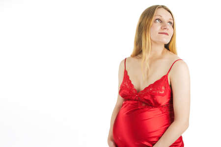 sensual young pregnant blonde in red nightshirt isolated on white Stock Photo - 5760186