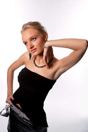 elegant young pretty blonde woman in black dress isolated on white photo