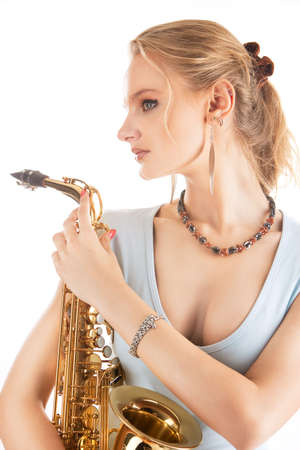 relaxing sexy nice blonde girl with sax isolated over white background photo