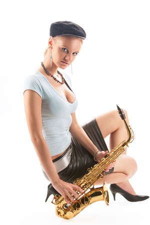 sensual blonde girl with passion look sitting with saxophone isolated over white photo